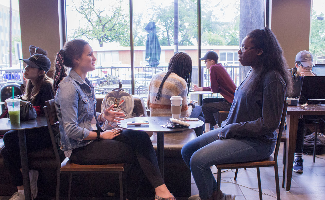 Students having coffee at starbucks